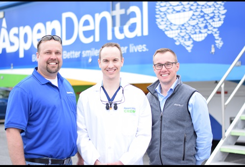 Dr. Nathan Oakes with volunteers Aspen Dental Springfield, MA